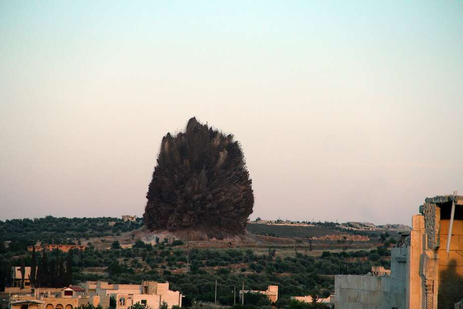 Tunnel bomb:Seen from Tel al-Sawadi, a large explosion rips through what it is believed to be the Wadi Deif   Syrian army base in northwestern Idlib. The Syrian Observatory for Human Rights said Islamist   rebels detonated explosives planted in a tunnel under the base, killing or injuring dozens.   Opposition fighters have been trying to capture the base for over a year. Photo: Ghaith Omran, AFP/Getty Images