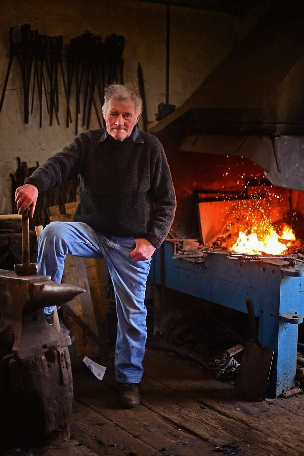 Peat and repeat: Calum Stealag Macleod, 79, works in his Stornoway Blacksmith shed making a 