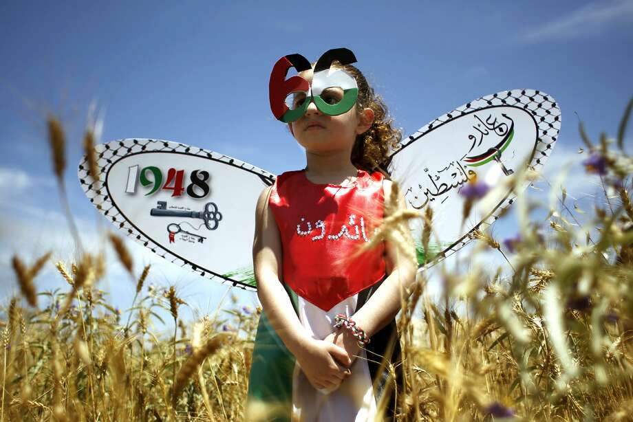 Catastrophe Day: In a field near Gaza City, a winged Palestinian girl marks Nakba, or Catastrophe Day, a reference to the birth of the state of Israel 66 years ago in British-mandate Palestine. The 1948 war over Israel's creation led to the displacement of hundreds of thousands of Palestinians, who either fled or were driven out of their homes. Photo: Said Khatib, AFP/Getty Images