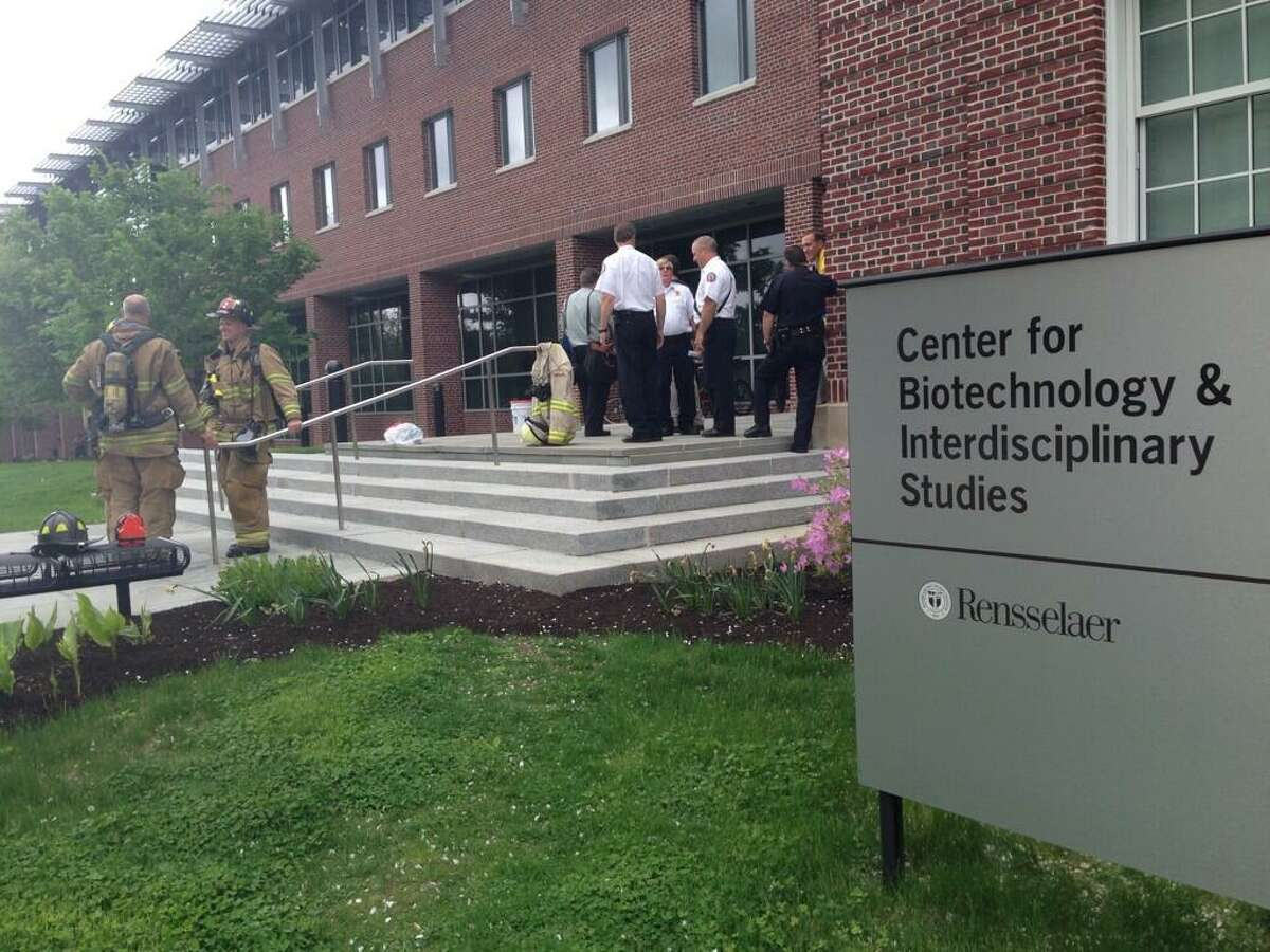 Emergency responders at the Center for Biotechnology building at RPI, which was evacuated Thursday because of chemical spill. (Lori Van Buren/Times Union)