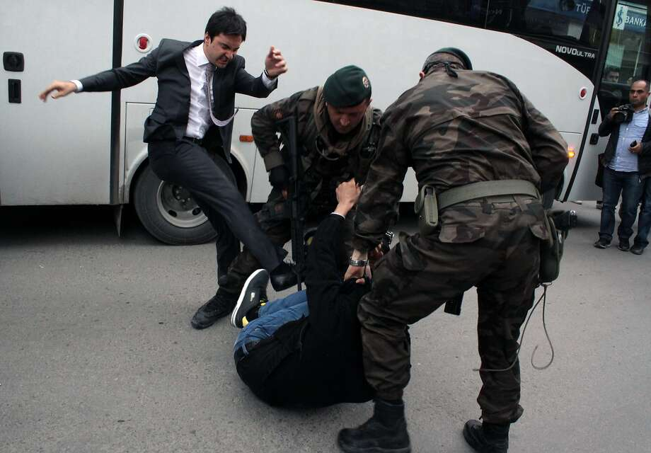 Minister's aide stomps a protester: A man identified by Turkish media as Yusuf Yerkel, adviser to Prime Minister Recep 