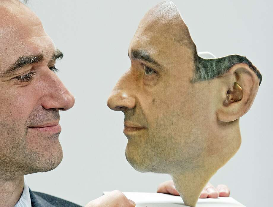 Technology finally matches the realism of 'Mission Impossible' masks:Mario Huettenhofer, chief of the German company 3D Fab, presents a 3D print of his own face at the   FabCon 3.D and Rapid.Tech fair in Erfurt, Germany. Photo: Jens Meyer, Associated Press