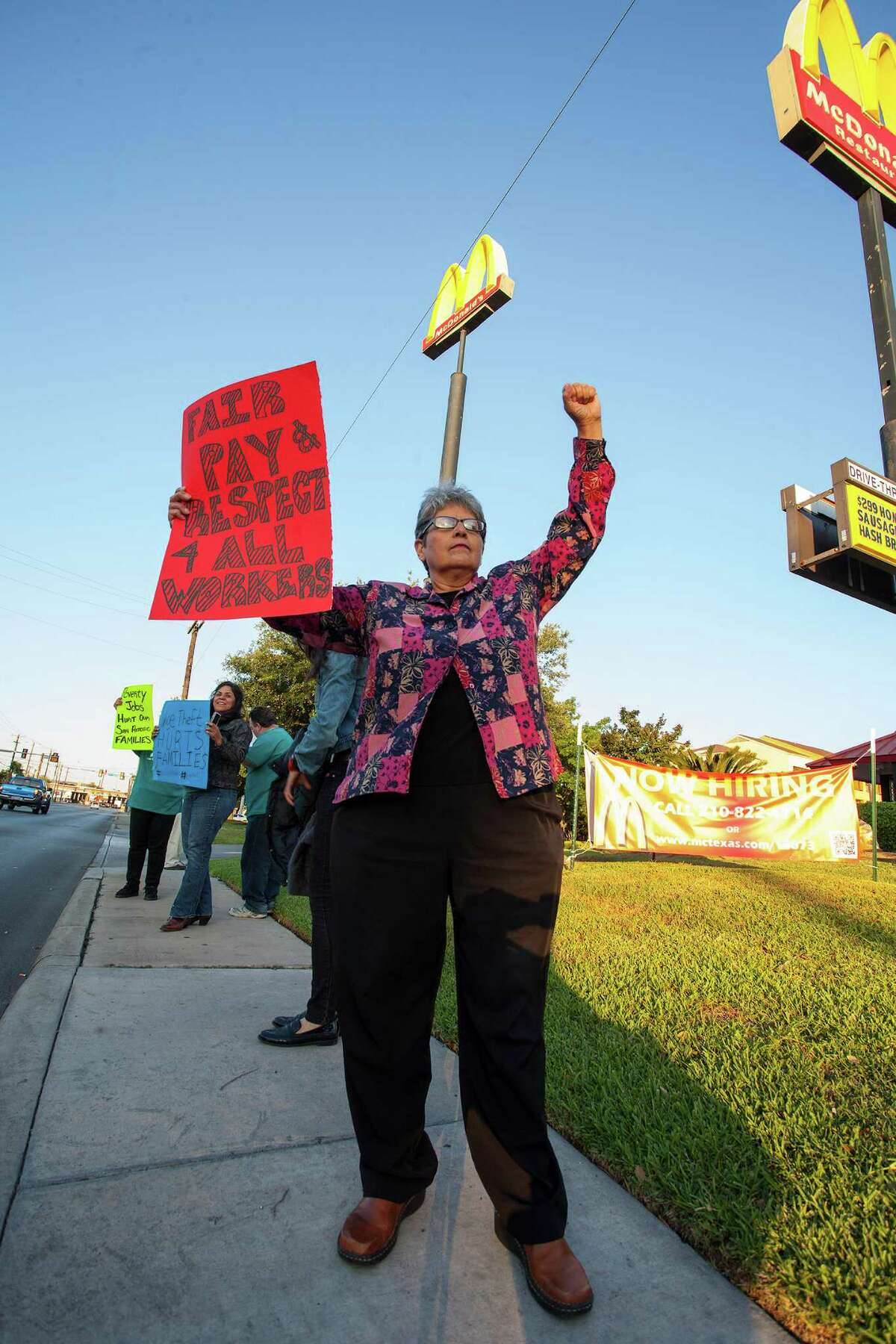 Irasema Cavazos is among the labor activists and fast food workers staging a protest calling for a $15 minimum wage and the right of fast food workers to form a union, outside a McDonald's in the 8600 block of Broadway, early Thursday, May 15, 2014 in San Antonio.