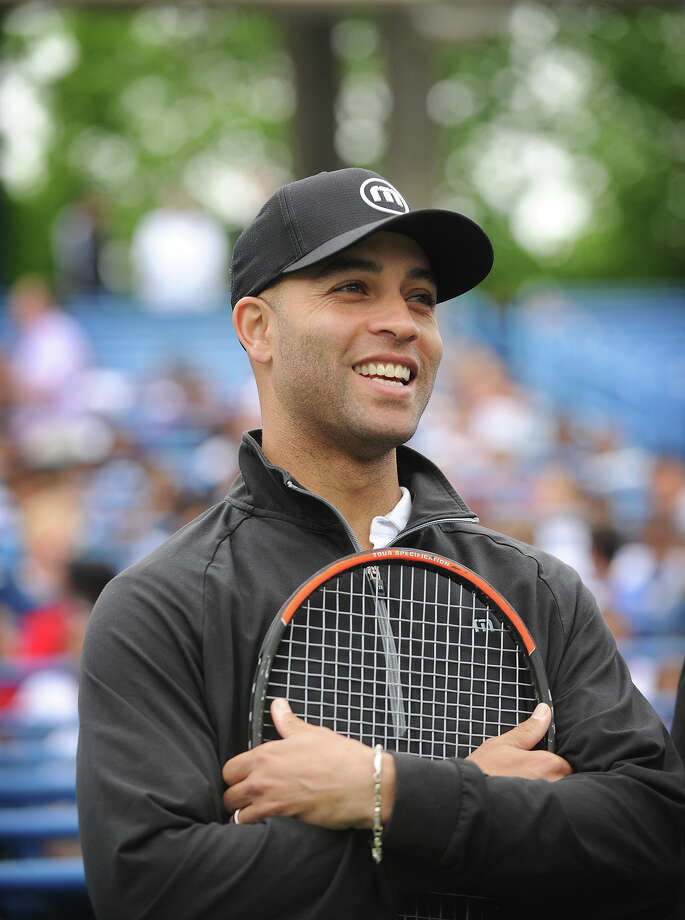 Fairfield High graduate and world tennis star James Blake is introduced to lead the 13th annual New Haven Open Free Lesson at the Connecticut Tennis Center in New Haven, Conn. on Thursday, May 15, 2014. Photo: Brian A. Pounds / Connecticut Post