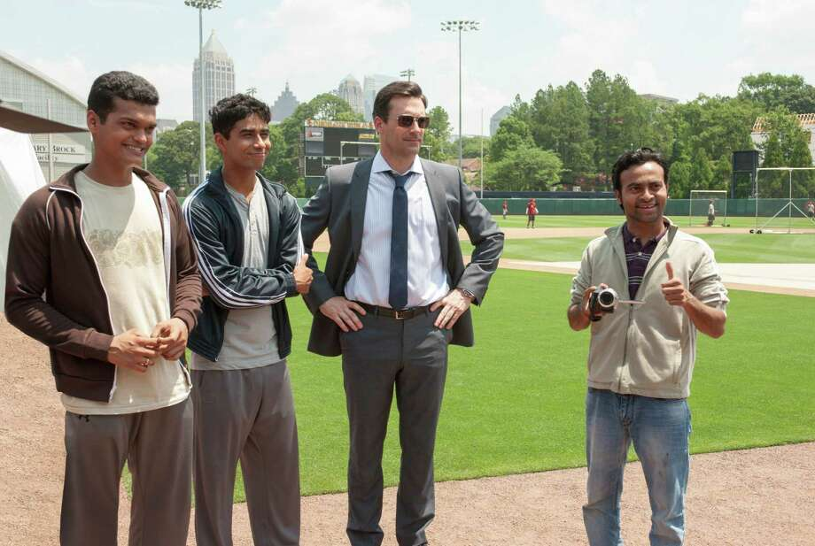 "Madhur Mittal, from left, Suraj Sharma, Jon Hamm and Pitobash star in ""Million Dollar Arm."" Photo: Ron Phillips, HOEP / Disney"