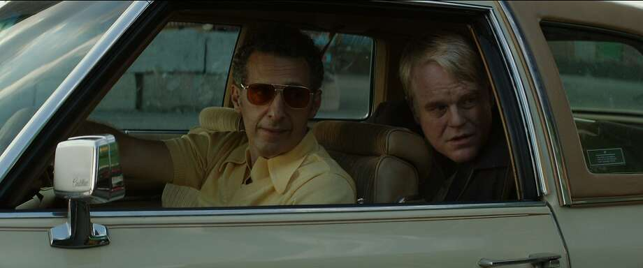 John Turturro and Philip Seymour Hoffman (Mickey Scarpato) in John Slattery's GOD'S POCKET. Photo: Lance Acord, IFC Films