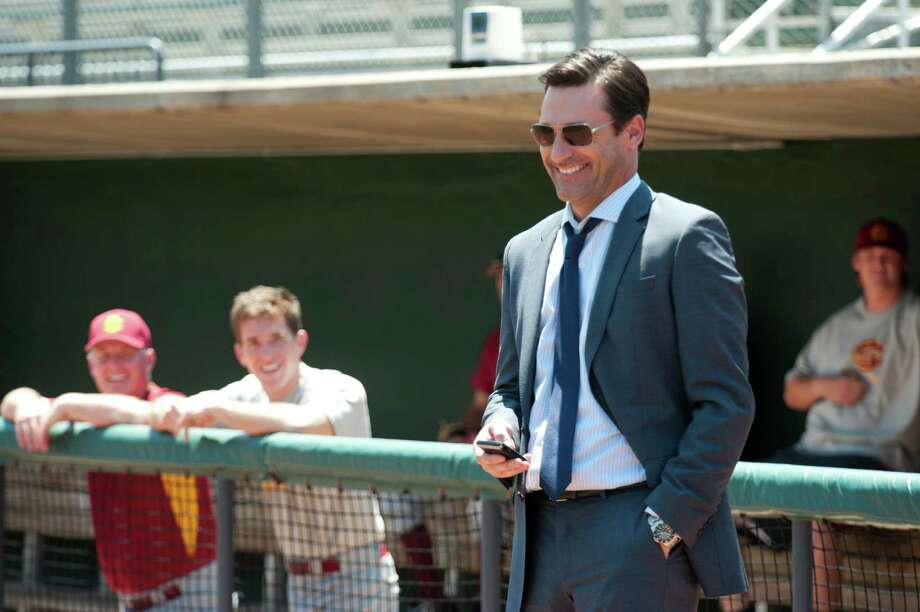 "This photo released by Disney Enterprises, Inc. shows Jon Hamm, right, as sports agent JB Bernstein in a scene from the Walt Disney Pictures' ""Million Dollar Arm."" The movie releases in U.S. theaters on Friday, May 16, 2014. (AP Photo/Disney Enterprises, Inc., Ron Phillips) Photo: Ron Phillips, Associated Press / Disney Enterprises, Inc."