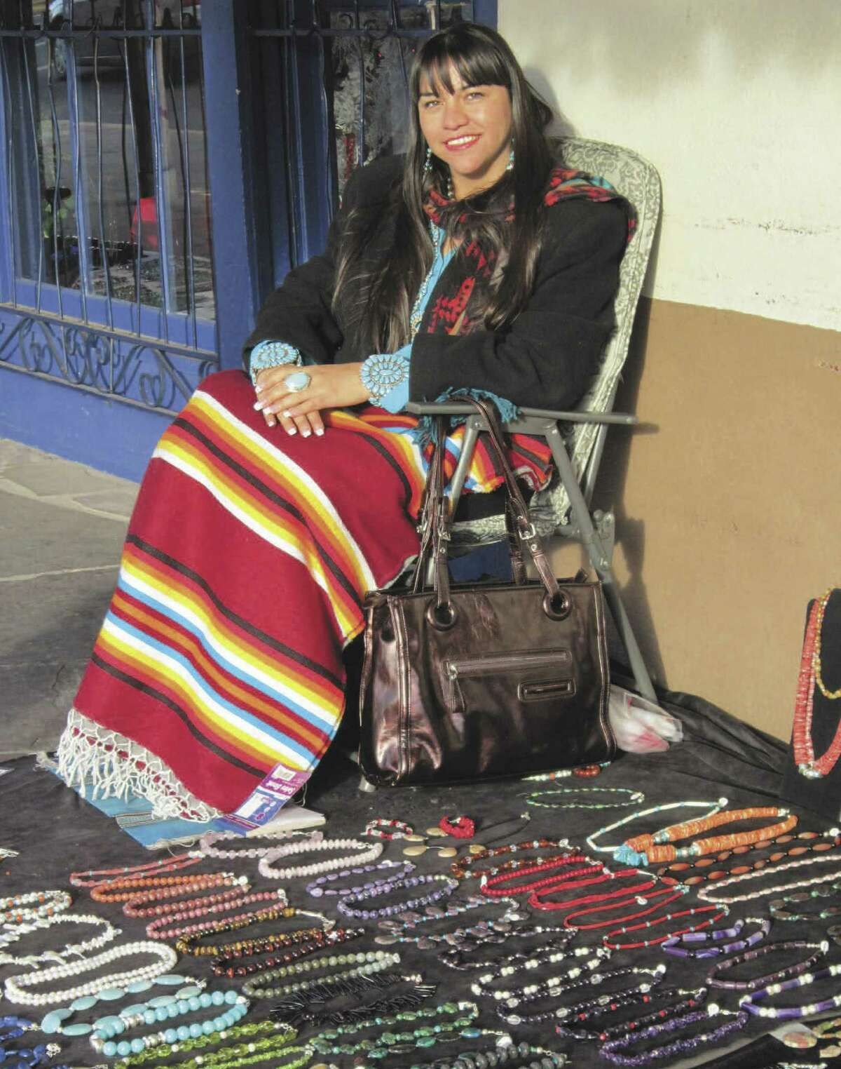 A vendor in Old Town Albuquerque displays her necklaces for sale.