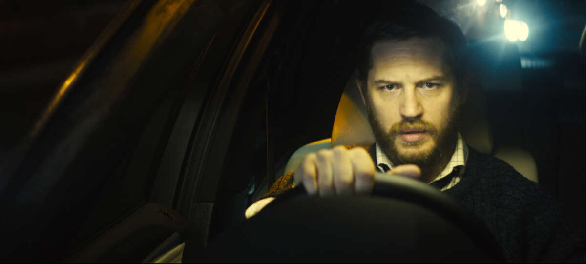 """This image released by A24 Films shows Tom Hardy in """"Locke."""" (AP Photo/A24 Films)"""