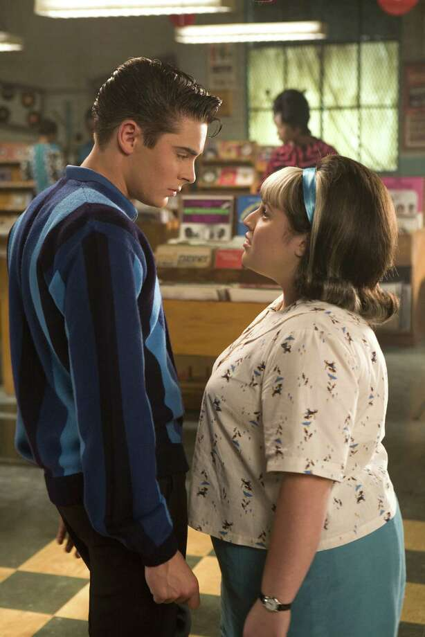 "Zac Efron (left) stars as ""Link Larkin"" and Nikki Blonsky (right) stars as ""Tracy Turnblad"" in New Line Cinema's musical, HAIRSPRAY. Photo courtesy David James/New Line Cinema ©2007 New Line Cinema Photo: David James / newline.wireimage.com"