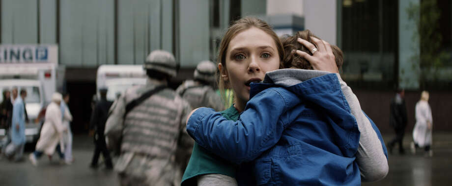 "Elizabeth Olsen and Carson Colde in ""Godzilla."" Photo: Courtesy Of Warner Bros. Picture / © 2014 Legendary Pictures Funding, LLC and Warner Bros. Entertai"