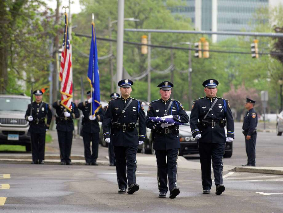 The honor guard presents the colors and changes the flag during a memorial service on Thursday, May 15, 2014, at Stamford Police headquarters to honor and remember Stamford police officers who have been kille din the line of duty. Photo: Lindsay Perry / Stamford Advocate