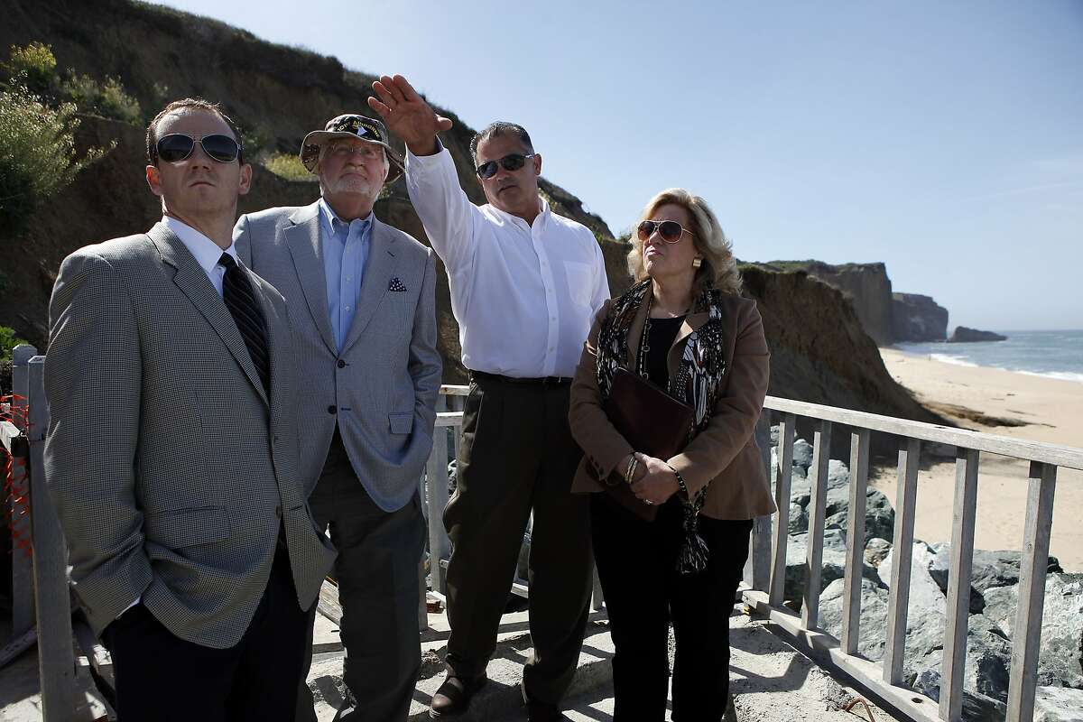 (L-R) Attorney's representing the plaintiff Surfrider Foundation, Eric Buescher and Joe Cotchett are shown features of Martin's Beach by property manager Steven Baugher as San Mateo Superior Court Judge Barbara Mallach looks on during a court visit to the disputed beach in Half Moon Bay, CA, Thursday May 15, 2014.