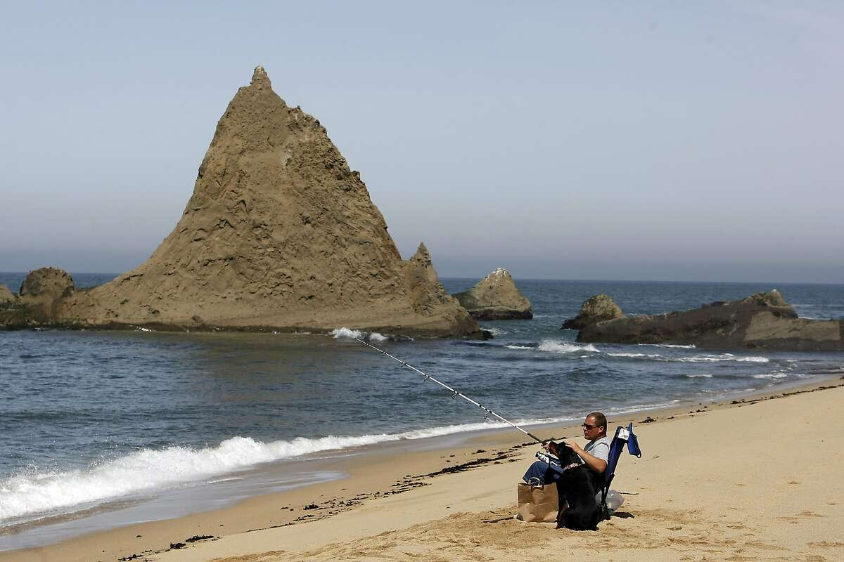 Bill White of Daly City fishes with his dog Bella at Martin's Beach in Half Moon Bay, CA, Thursday May 15, 2014. Bill has a friend that lives at Martin's Beach and grants him access to the area that is now closed to the public.