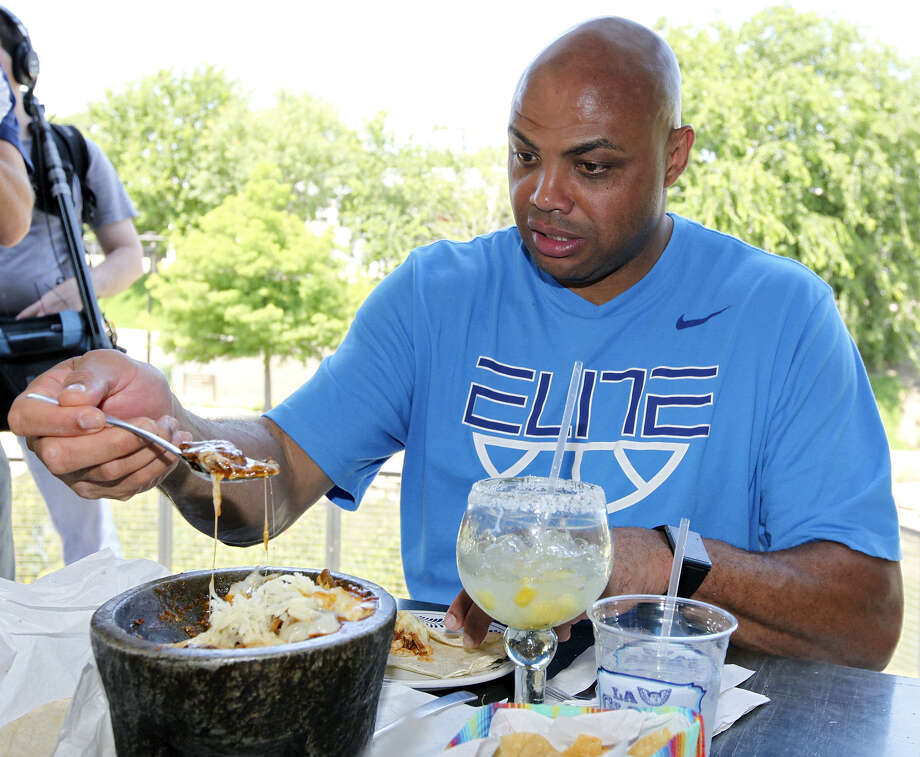 Whoa! That looks fattening, Barkley. Charles Barkley tries one of the molcajete dishes at La Gloria Ice House in 2012. Barkley has recently made fat jokes about San Antonio women. Photo: Express-News File Photo / © 2012 San Antonio Express-News