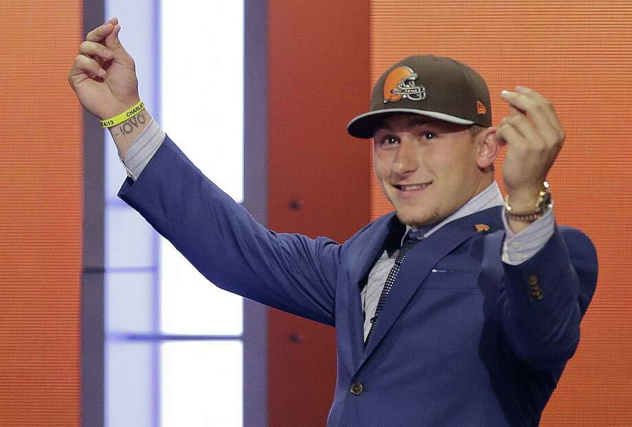 Former Texas A&M quarterback Johnny Manziel felt like celebrating after the Cleveland Browns selected him in the NFL draft. But one fan cautions that Manziel may end up like other Browns quarterbacks of the recent past. Photo: Frank Franklin II / Associated Press / AP
