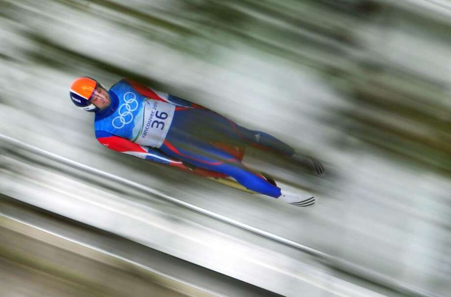 WHISTLER, BC - FEBRUARY 13:  Viktor Kneib of Russia practices in the men's luge singles training during the Luge Men's Singles on day 2 of the 2010 Winter Olympics at Whistler Sliding Centre on February 13, 2010 in Whistler, Canada.  (Photo by Clive Mason/Getty Images) *** Local Caption *** Viktor Kneib Photo: Clive Mason, Getty Images / 2010 Getty Images