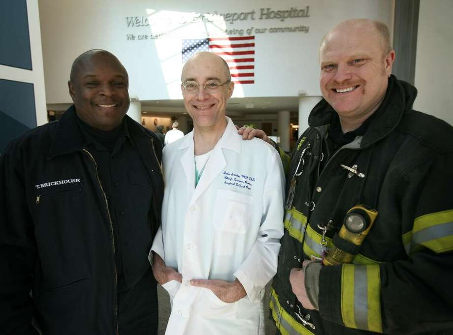 From left; Bridgeport firefighter Tim Brickhouse, John T. Schulz, MD, medical director of the Panettieri Burn Center at Bridgeport Hospital, and Bridgeport firefighter Michael Kamszik, at Bridgeport Hospital on Thursday, February 11, 2010. Both firefighters have been treated at the hospital for burns received while fighting fires. Photo: Brian A. Pounds / Connecticut Post