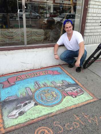 Scott Somerville of Loudonville honors the Albany Police and Fire Departments in his work during the chalk contest at the Tulip Festival in Albany. (Beth Harbour)