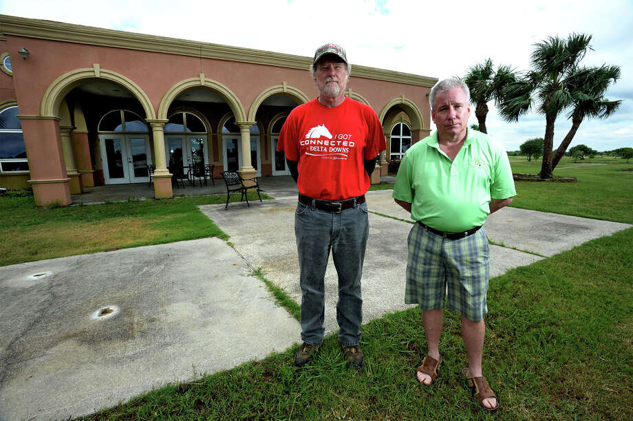 With expectations of a late July reopening, Jeff Vrooman, left, and Kevin Johnson have been cleaning up the fairways, cart paths and clubhouse at the Palms on Pleasure Island for several months.  Photo taken Wednesday March 14, 2014 Guiseppe Barranco/@spotnewsshooter Photo: Guiseppe Barranco, Photo Editor