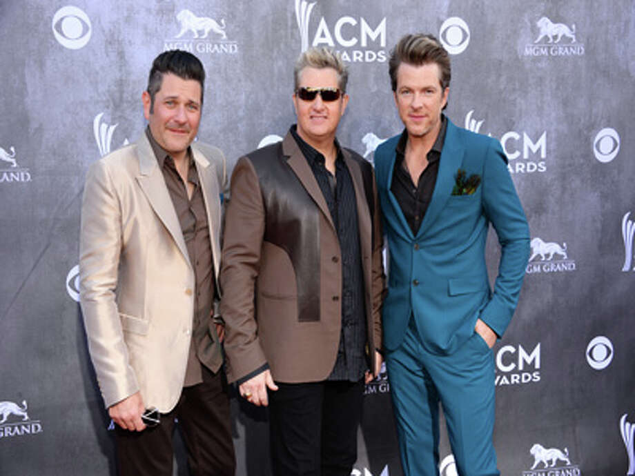 Jay DeMarcus, and from left, Gary LeVox and Joe Don Rooney, of the musical group Rascal Flatts, arrive at the 49th annual Academy of Country Music Awards at the MGM Grand Garden Arena on Sunday, April 6, 2014, in Las Vegas. Photo: Al Powers/Powers Imagery, Al Powers/Powers Imagery/Invision/AP / Invision
