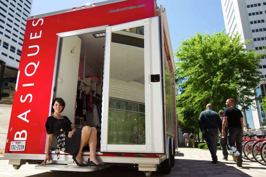 Sheri Falk's mobile fashion boutique, Basiques, has a camera that offers scans to let shoppers put their measurements on file for future purchases. Photo: Marie D. De Jesus, Staff / © 2014 Houston Chronicle