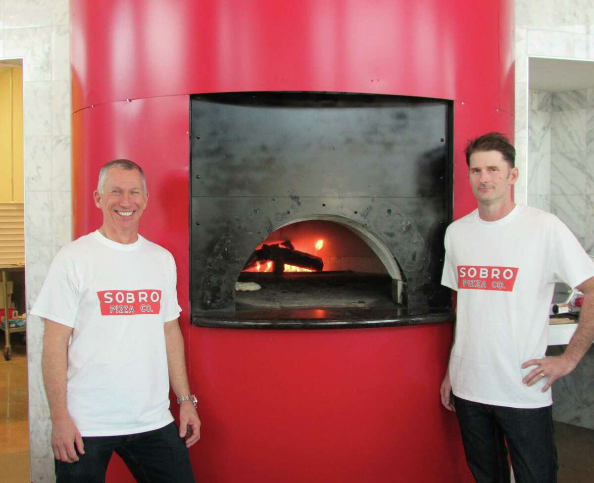 Paul Hughes (left) and Gerry Shirley are co-owners of the Sobro Pizza Co., located on Broadway near The Pearl. It opened April 21.