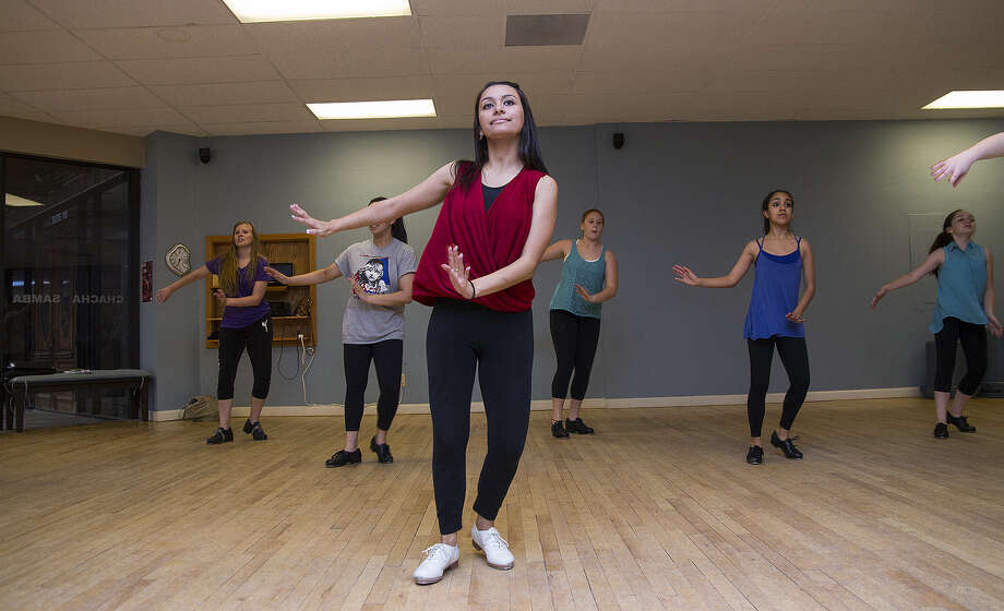 Cassandra Cantu, 17, leads members of the RPM Youth Tap Ensemble as they rehearse for a performance to celebrate National Tap Dance Day. Photo: Photos By Alma E. Hernandez / For The Express-News