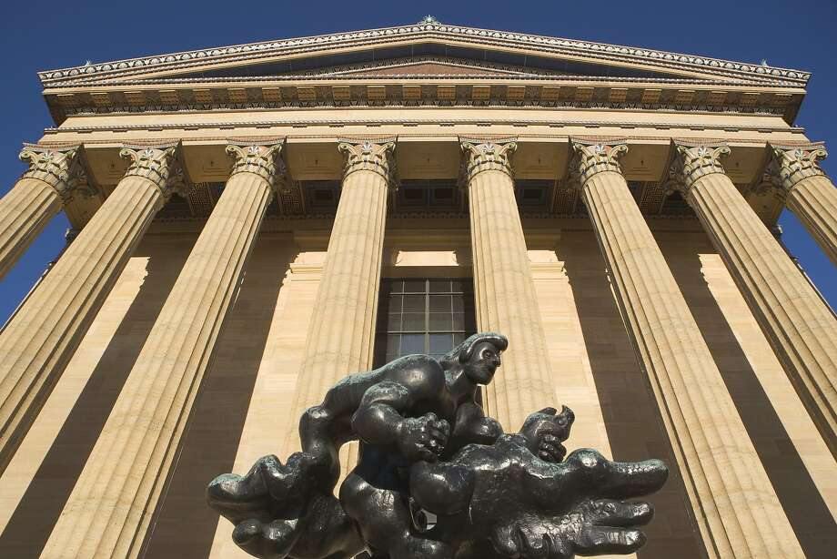 "Looking up at the hilltop Philadelphia Museum of Art, a Greek Revival building that showcases world-class art inside and, outside, a highlight of pop culture, the ""Rocky"" steps. Photo: Fotog, Getty Images"