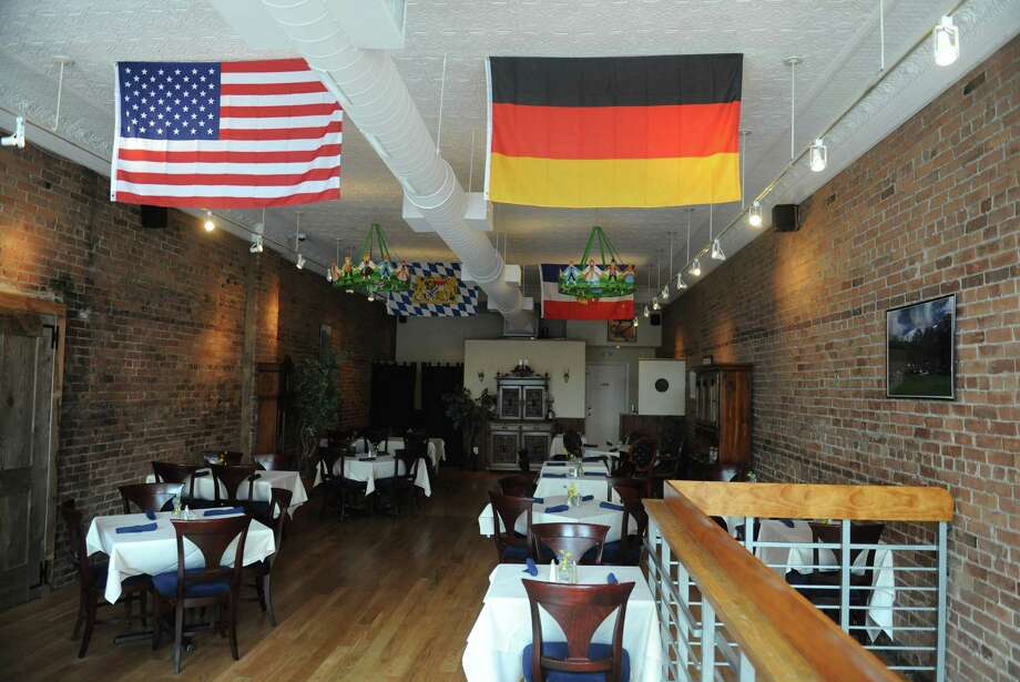 The interior of The Alpenhaus restaurant in New Milford, Conn. features a German and an American flag.  The restaurant and bar offer authentic German cuisine from owner and chef Manuela Dürre-Young and is located on the corner of Bank Street and Railroad Street in downtown New Milford. Photo: Tyler Sizemore / The News-Times