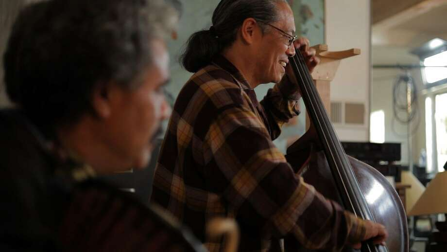 """One focus of """"Don't Lose Your Soul"""" is bassist Mark Izu, who often performs with his wife, Brenda Wong Aoki. Photo: Center For Asian American Media"""
