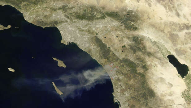 This May 14, 2014, shot from NASA's Aqua satellite shows raging wildfires just north of San Diego, Calif. Officials  issued thousands of evacuation notices for residents in the area. The fire destroyed several homes and caused millions of dollars worth of damages, the Associated Press reports.
