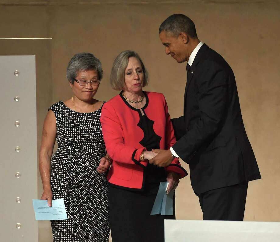 President Barack Obama talks with Ling Young, left, and Alison Crowther before their remarks during the dedication ceremony in Foundation Hall, of the National September 11 Memorial Museum, in New York, Thursday, May 15, 2014. Young was working on the 86th floor of the South Tower and was one of 12 people who escaped the sky lobby after Flight 175 struck the World Trade Center. Crowther is the mother of Welles Crowther who was killed on September 11 while assisting in the evacuation efforts in the South Tower. Photo: TIMOTHY A. CLARY, Associated Press / Pool AFP