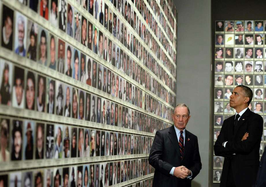 US President Barack Obama is accompanied by former New York Mayor Michael Bloomberg as he tours the National September 11 Memorial & Museum on May 15, 2014 in New York. Obama inaugurated the museum commemorating the September 11, 2001 terrorist attacks. Photo: JEWEL SAMAD, AFP/Getty Images / AFP
