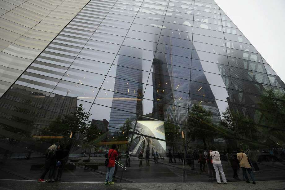An image of one of the original World Trade Center Towers is displayed in the window of the  9/11 Memorial Museum pavilion dedication ceremony at the National September 11 Memorial Museum in New York on Thursday,  May 15, 2014. Photo: Anthony Behar, Associated Press / POOL SIPA