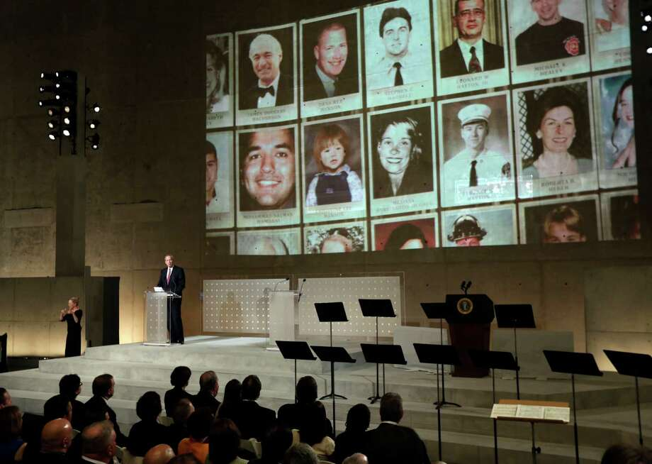 Former New York Gov. George Pataki speaks as photos of 9/11 victims are projected, during the dedication ceremony in Foundation Hall, of the National September 11 Memorial Museum, in New York, Thursday, May 15, 2014. Photo: Richard Drew, Associated Press / Pool AP