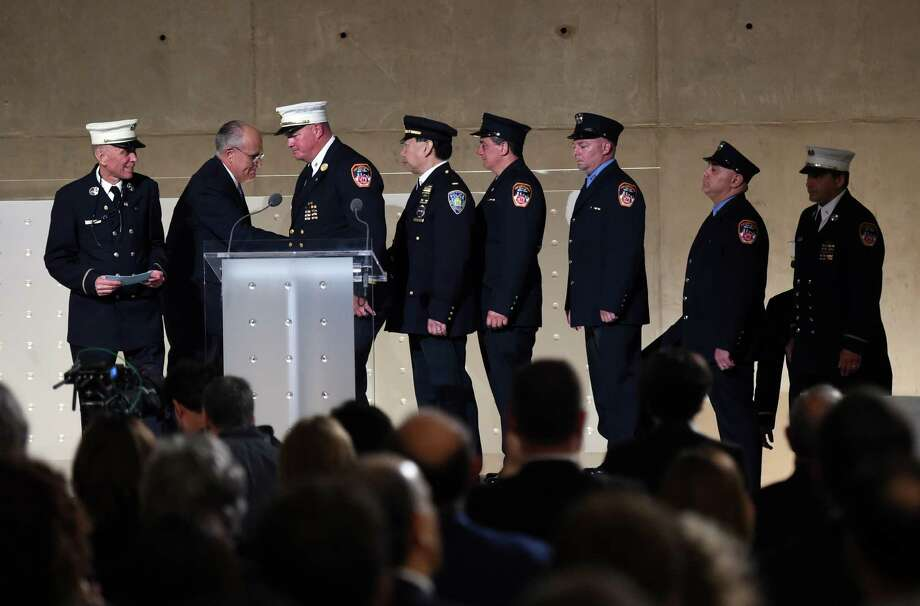 Former New York City Mayor Rudolph Giuliani greets New York City Fireman at the dedication of the National September 11 Memorial Museum, in New York, Thursday, May 15, 2014. Photo: TIMOTHY A. CLARY, Associated Press / Pool AFP
