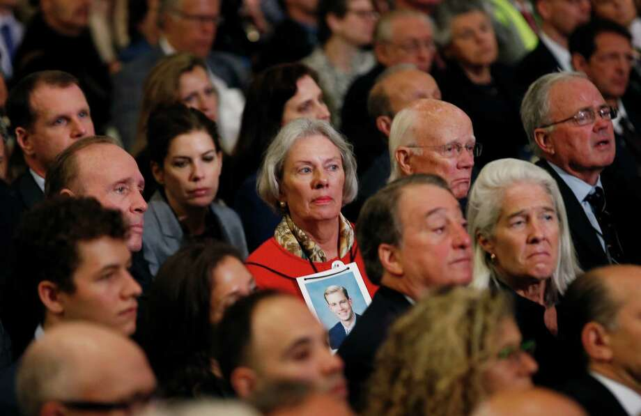 A woman wears a photograph of a victim of the September 11 2001 attacks on the World Trade Center around her neck as she attends the dedication ceremony at the National September 11 Memorial Museum in New York,  Thursday, May 15, 2014. The museum, commemorating the Sept. 11, 2001 attacks on New York and Washington opens to the public on May 21, with wrenchingly familiar sights as well as artifacts never before on public display. Photo: MIKE SEGAR, Associated Press / Pool Reuters