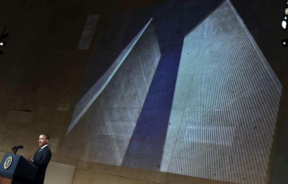 US President Barack Obama speaks as an image of the twin towers are projected during a ceremony at the National September 11 Memorial & Museum on May 15, 2014 in New York. Obama inaugurated the museum commemorating the September 11, 2001 terrorist attacks. Photo: JEWEL SAMAD, AFP/Getty Images / AFP