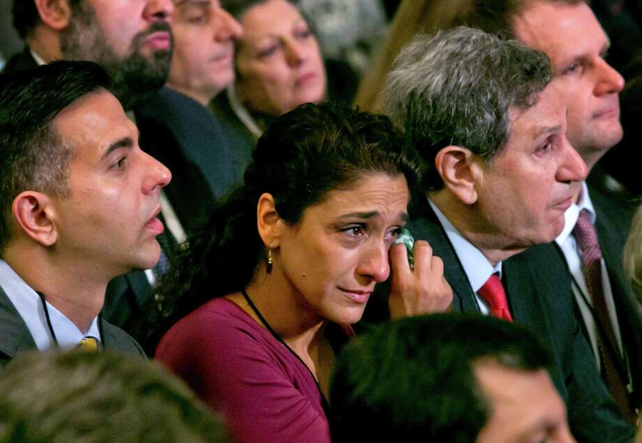 A woman in the audience dries a tear during the dedication ceremony in Foundation Hall, of the National September 11 Memorial Museum, in New York, Thursday, May 15, 2014. Photo: Richard Drew, Associated Press / Pool AP