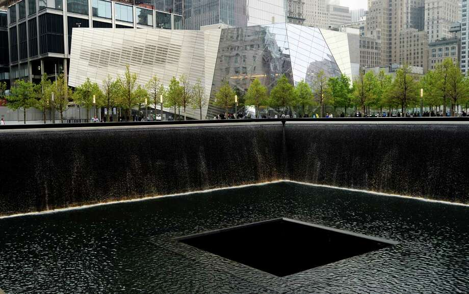 A view of the National September 11 Memorial Museum with the north reflecting pool in foreground during the museum's dedication ceremony Thursday, May 15, 2014 in New York. Photo: JUSTIN LANE, Associated Press / Pool EPA