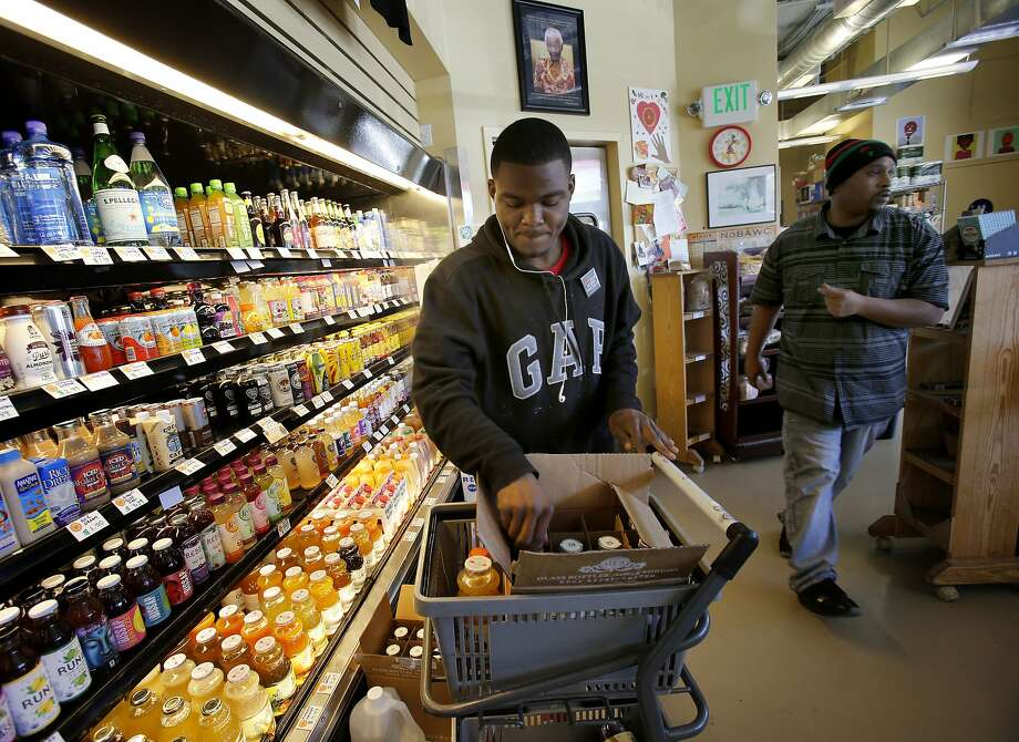 A large selection of beverages from organic juice to coconut water to nut milks is popular with customers at Mandela Foods Cooperative in Oakland. Photo: Brant Ward, The Chronicle