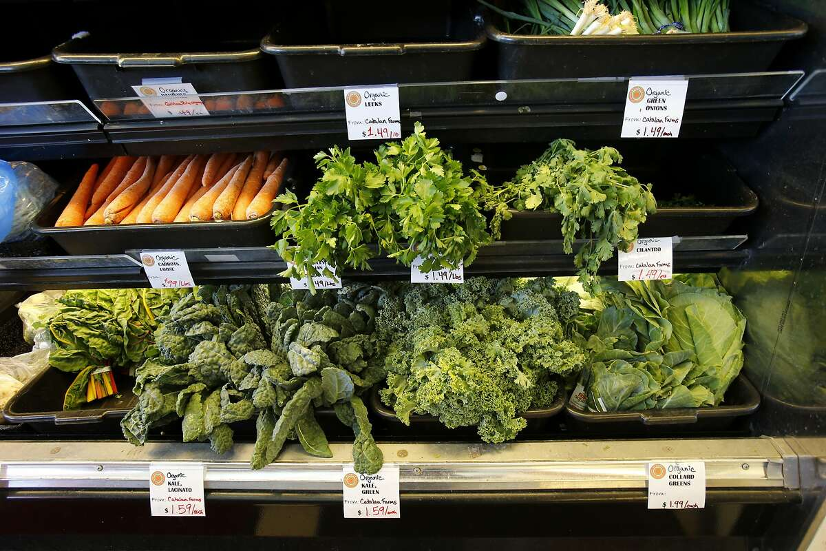 A variety of locally grown greens and vegetables are available Monday May 12, 2014 in Oakland, Calif. A new wave of small full-service independent markets have been opening up in urban areas like the Mandela Foods Cooperative.
