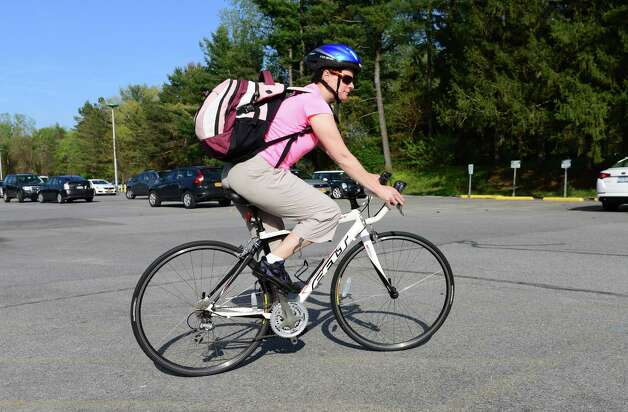 Cathleen Crowley rides home after work at the Times Union Monday evening, May 12, 2014, in Colonie, N.Y. (Will Waldron/Times Union) Photo: WW / 00026868A