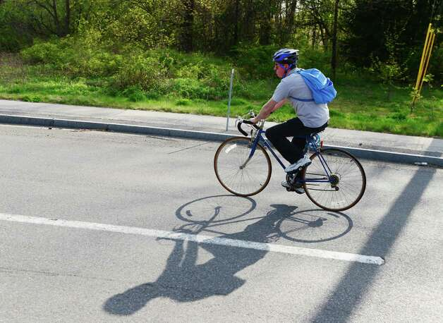 Tim O'Brien navigates the roundabout at Albany Shaker and Maxwell Roads while riding home from work at the Times Union Monday evening, May 12, 2014, in Colonie, N.Y. (Will Waldron/Times Union) Photo: WW / 00026868A
