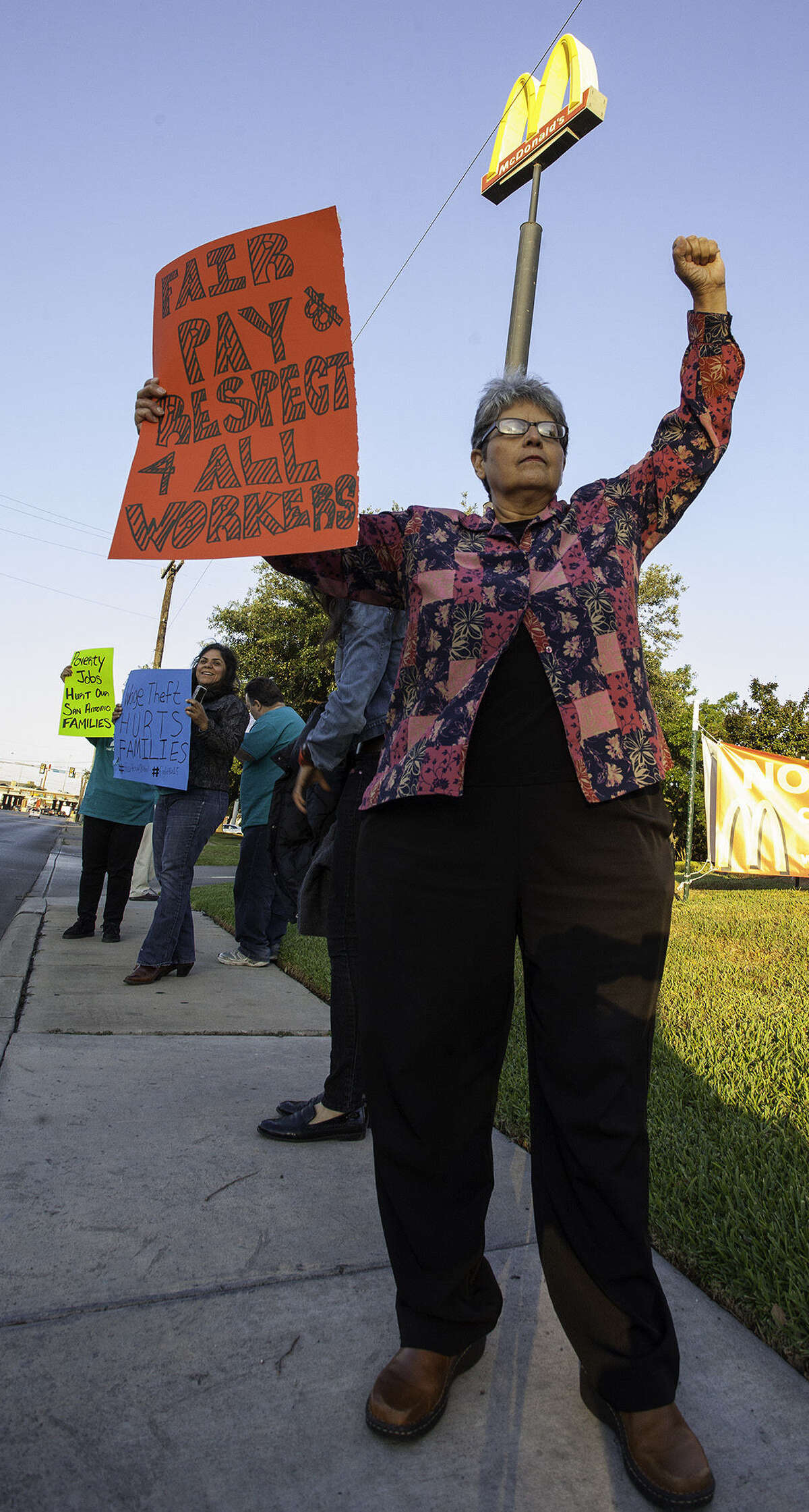 Irasema Cavazos is among the labor activists and fast-food workers staging a protest calling for a $15 minimum wage and the right of fast-food workers to form a union, outside a McDonald's in the 8600 block of Broadway.