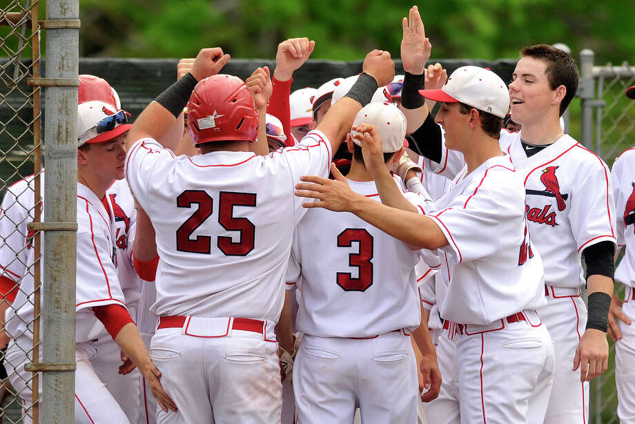 The Greenwich baseball team congratulates Justin Gaccione (#25) after he hit a home run during their baseball game against Stamford at Greenwich High School in Greenwich, Conn., on Thursday, May 15, 2014. Greenwich won, 8-4. Photo: Jason Rearick / Stamford Advocate