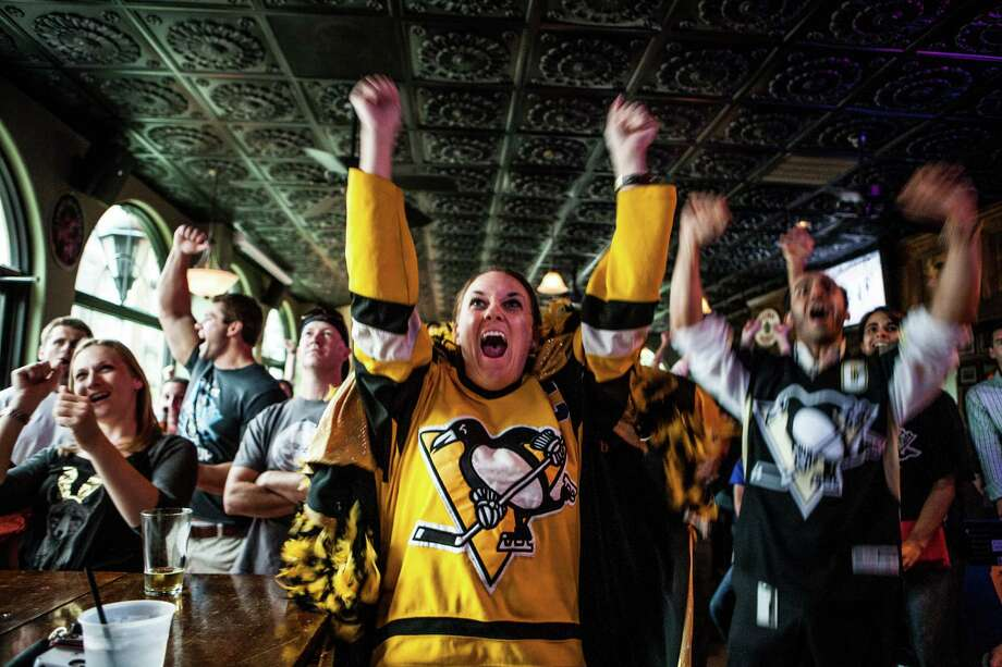 At the Maple Leaf Pub, Jamie Wright celebrates a Pittsburgh Penguins goal during their playoff game against the New York Rangers on Tuesday. Photo: Michael Starghill, Jr., Photographer / © 2014 Michael Starghill, Jr.
