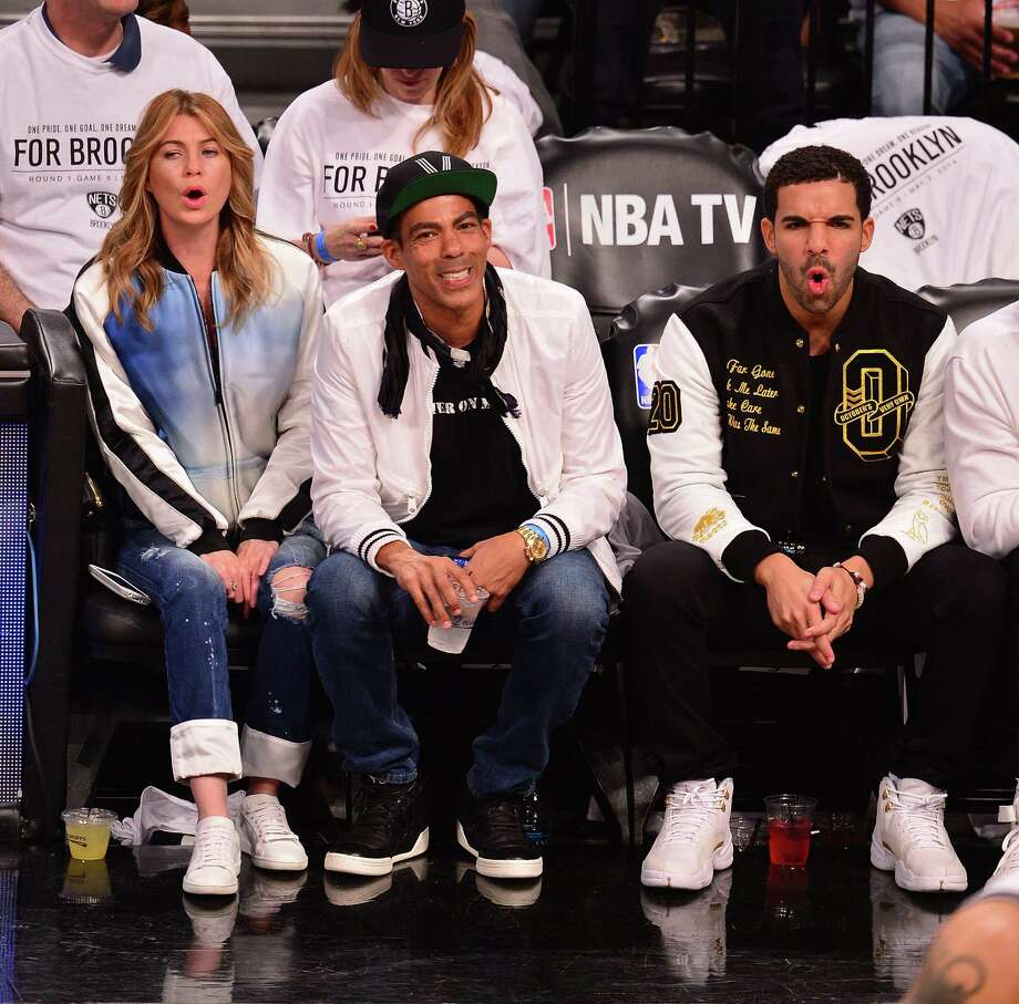 Ellen Pompeo on May 2, 2014, at a Brookyn Nets game with husband Chris Ivery, center, and rapper Drake, right. Photo: James Devaney, Getty Images / 2014 James Devaney