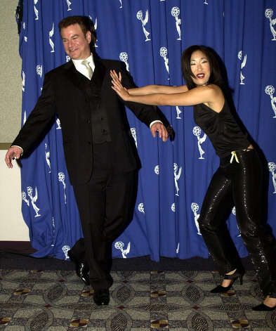 "Sandra Oh with Robert Wuhl in 2000, when they starred in the HBO series ""Arli$$."" Photo: Steve W. Grayson, Getty Images / Hulton Archive"